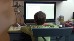 Little boy typing at a computer, kid, pupil doing homework at home Stock Footage