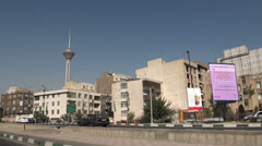 Tehran, driving towards Milad towers through city's suburbs Stock Footage