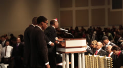 african/american pastor speaks to his congregation - stock footage