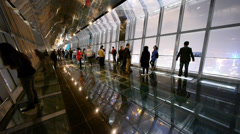 People in sightseeing hall,modern glass building inter. Stock Footage