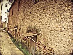 Stock Photo of small lane between two buildings