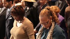 african/american church congregation holding hands and praying - stock footage