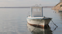 Fishing boat in the small port Stock Footage