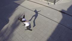 AERIAL SLOW MOTION: Skateboarding trick Stock Footage