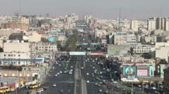 Tehran, Iran, major highway runs through city, mural paintings on buildings Stock Footage