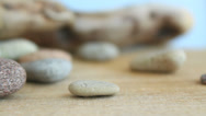 Stock Video Footage of Stones on wooden surface, harmony