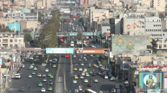 Tehran Iran traffic mural paintings war heroes religion Islamic Republic - stock footage