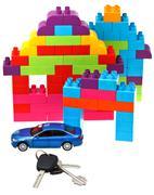 Keys, model car, plastic block house Stock Photos