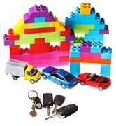 keys, model car, plastic block house - stock photo