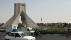 Tehran, Iran, Azadi Tower monument and traffic Stock Footage