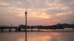 Beautiful time lapse of the Macau Tower sunset Stock Footage