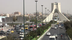 Tehran, Azadi Tower, landmark monument, rush hour traffic Stock Footage