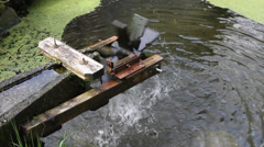 Watermill water wheel pond Stock Footage