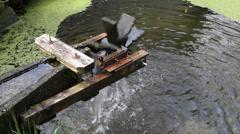 Watermill medium shot pond Stock Footage