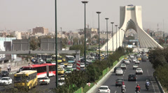 Tehran traffic, Azadi Freedom monument, square, intersection, busy road Stock Footage