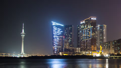 Time lapse of the Macau skyline with the Macao Tower and Casinos at night Stock Footage