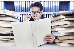 Analyzing business books Stock Photos