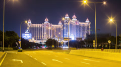 Night time lapse moving towards the Galaxy Macau casino and hotel resort Cotai Stock Footage