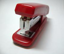 red stapler isolated on the white background - stock photo