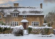 Stock Photo of cotswold cottage in snow
