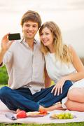 couple taking selfie with mobile phone - stock photo