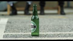 Breaking bottle Stock Footage