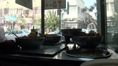 Tehran, Iran, roadside snack, falafel restaurant, busy street Stock Footage