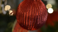 Closeup of a Red Bauble on a Christmas Tree Stock Footage