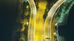 Moving up a busy freeway at night time lapse - stock footage