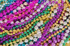 Mardi Gras beads background Stock Photos