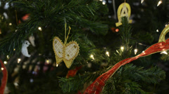 Butterfly Christmas Ornaments on a Christmas Tree Stock Footage
