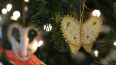 Closeup of Butterfly Christmas Tree Ornaments Stock Footage