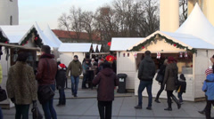 white wooden christmas market kiosk at city street invite people - stock footage