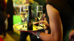 Champagne Wishes | cocktail waitress w/ Champagne flutes - stock footage