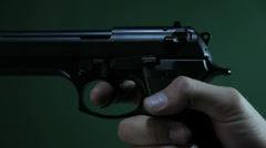 Pulling trigger and shoot on green Stock Footage