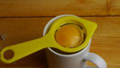 Separating the yolk and egg white Stock Footage