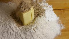 Ingredients for the dough, flour, ground nuts and butter on wooden table. Stock Footage