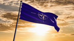NATO Flag, HQ animated on an epic sunset background Stock Footage