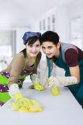 Asian couple cleaning new home Stock Photos