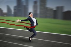 Businesswoman winning the race Stock Illustration