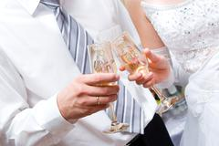 Newly-married couple with full glasses Stock Photos
