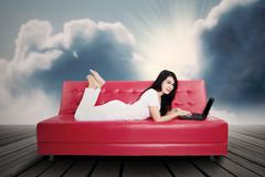 Enjoying time by using laptop outdoors Stock Illustration