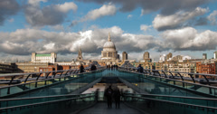 4K time lapse of clouds and people passing by St Paul's Cathedral in London Stock Footage