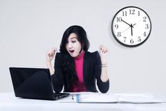 terrified businesswoman looking at laptop - stock photo