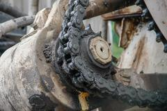 old chain with propel roller - stock photo