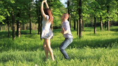 Happy couple dance funny in the Park - stock footage