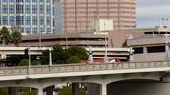 Bicyclist riding over a bridge, downtown Tampa Stock Footage