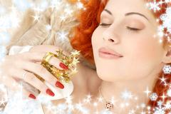 Dreaming redhead with white christmas bells snowflakes Stock Illustration