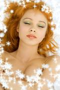 Dreaming redhead with snowflakes Stock Illustration