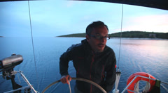 Stock Video Footage of Skipper on sailing boat on Adriatic sea off the coasts of Croatia.